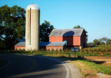 Farm on a Curve. This is a shot of a barn and silo in the curve of the road Stock Image