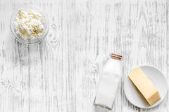 Farm dairy products. Milk, cottage, cheese on light wooden background top view copyspace. Farm dairy products wooden background top view Royalty Free Stock Photos
