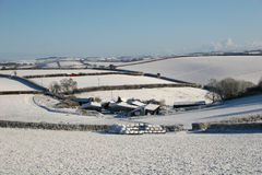 Farm in Devon. Farm in the snow in Devon royalty free stock photography