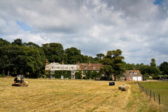 Farm in Dorset. Making hay on a farm in Dorset, UK Royalty Free Stock Images