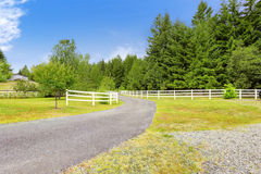 Farm driveway with wooden fence in Olympia, Washington state Royalty Free Stock Photos