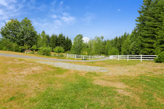 Farm driveway with wooden fence in Olympia, Washington state Royalty Free Stock Photography
