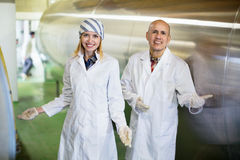 Farm employees working in raw milk sector Royalty Free Stock Image