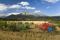 Farm equipment in field with sweeping views of Parque National de Ordesa near Ainsa, Huesca, Spain in Pyrenees Mountains Royalty Free Stock Photography