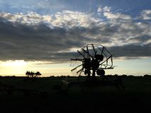 Farm equipment in Friesland. Farm equipment during sunset in Friesland The Netherlands Royalty Free Stock Images