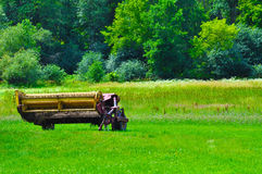 Farm equipment in a green field Royalty Free Stock Photography