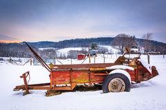 Farm equipment in a snow covered field in rural Carroll County, Stock Images