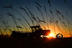 Farm Equipment at Sunset stock images