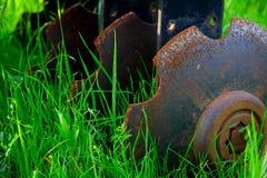 Farm Equipment Tiller in Field. Farm Equipment Tiller Rusting in Meadow Field Stock Images