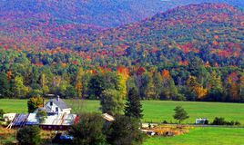 Farm and Fall Colors. This image of the beautiful New England fall foilage was taken in the Baker River valley of New Hampshire Stock Images
