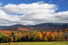 Farm in fall season with colorful mountain and forest Royalty Free Stock Photos