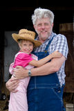 Farm family grandpa and little girl Royalty Free Stock Photos
