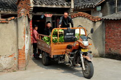 Jiu Chi Town, China: Family Loading Vegetables Royalty Free Stock Photos