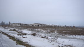 Farm from far away in winter stock video footage