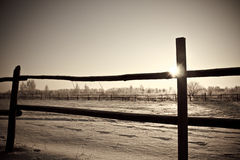 Farm fence. Black and white old photo of the farm wooden fence in winter Stock Photos