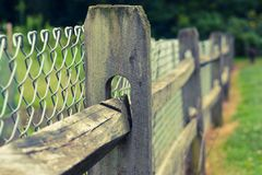 Farm fence wood chainlink. Wood and chainlink fence with bokeh background Stock Photography