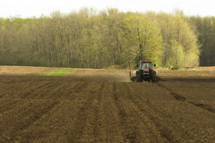 Farm field being tilled Royalty Free Stock Photo