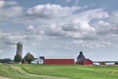 Farm field farm buildings and silo Stock Image