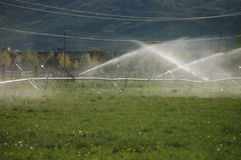 Farm field sprinkling system Royalty Free Stock Image