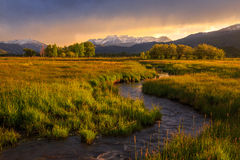 Farm field and stream sunset in rural Utah. Royalty Free Stock Images
