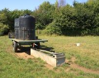Farm field water trough Stock Photo