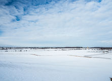 Farm Field In Winter. Snow blue sky Royalty Free Stock Photography