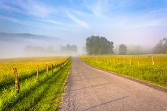Farm fields along a country road on a foggy morning in the Potom Royalty Free Stock Photos