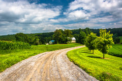 Farm fields along a dirt road in rural Carroll County, Maryland. Stock Photography