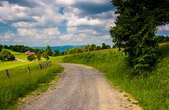 Farm fields along a dirt road in the rural Potomac Highlands of Royalty Free Stock Photography