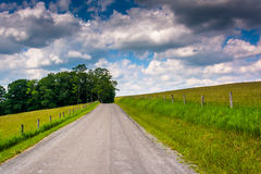 Farm fields along a road in the rural Potomac Highlands of West Stock Photo