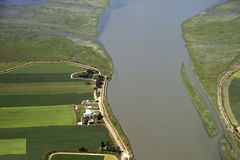 Farm and fields by the swamp river Stock Photos
