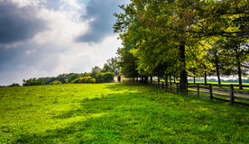 Farm fields and trees in rural Southern York County, Pennsylvani Stock Photo