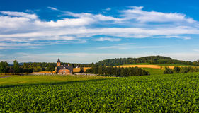 Farm fields and view of a church in rural York County, Pennsylva Royalty Free Stock Images