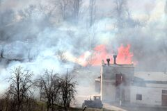 Farm fire. Burning building and agricultural machinery.