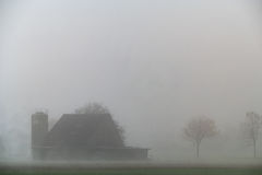 Farm in fog. A farm in the thick fog and landscape in the foreground Royalty Free Stock Photos