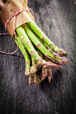 Farm fresh asparagus tips in a brown wrapper Stock Images