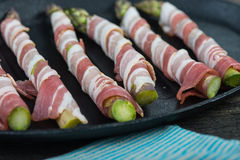 Farm fresh asparagus wrapped in pancetta or bacon and baked Royalty Free Stock Photography