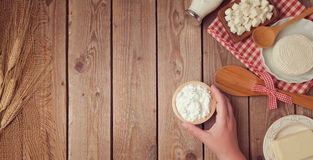 Farm fresh dairy products on wooden background. Healthy eating concept. Stock Photo