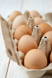 Farm fresh eggs in a cardboard tray Royalty Free Stock Photography