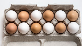 Farm fresh eggs. Carton of white and brown eggs Royalty Free Stock Photos