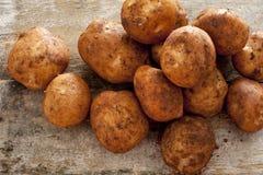 Farm fresh or home grown rustic potatoes Stock Image