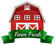 A farm fresh label with a red wooden house Stock Photo