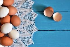 Farm Fresh Organic Eggs. A top view image of farm fresh organic eggs on a bright blue background royalty free stock photo