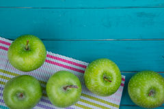 Farm fresh organic green apples on wooden retro blue table in ba Royalty Free Stock Photography