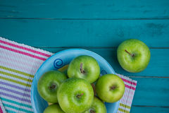 Farm fresh organic green apples on wooden retro blue table in ba Stock Photography