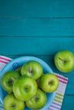 Farm fresh organic green apples on wooden retro blue table in ba Stock Photo
