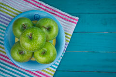 Farm fresh organic green apples on wooden retro blue table in ba Stock Image