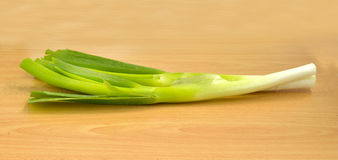 Farm fresh organic leek. Spring salad ingredient on wooden table, selective focus Stock Photography