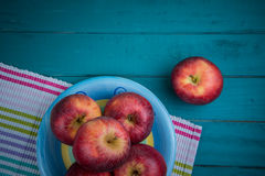 Farm fresh organic red autumn apples on wooden retro blue table Stock Photo