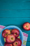 Farm fresh organic red autumn apples on wooden retro blue table royalty free stock image
